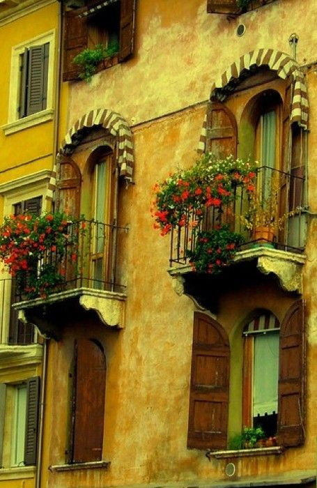 Renaissance balconies above the Caffe Al Teatro in Verona, Italy